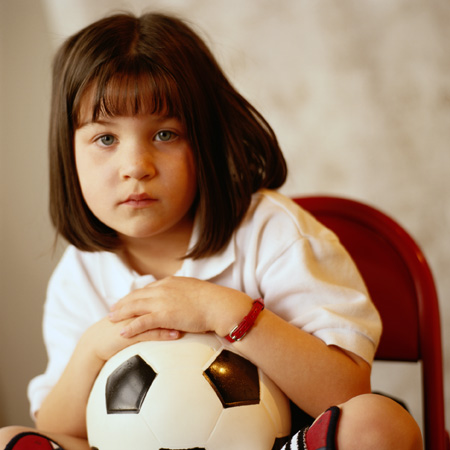 Sad Girl Holding Soccer Ball